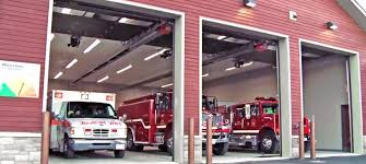 The photo above is a picture taking of the Fire House. It shows the trucks in the garage, such as two fire trucks and one ambulance vehicle.